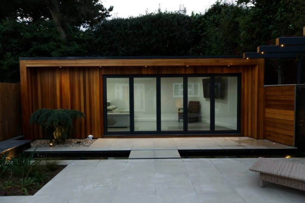 Timber clad garden room with bi-fold doors